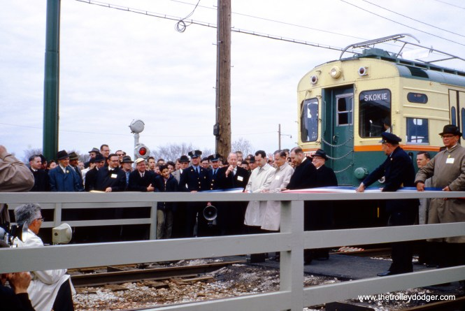 Officials from Skokie and the CTA cut the ribbon at Dempster Street on April 20, 1964, inaugurating Skokie Swift service on file miles of trackage formerly owned by the North Shore Line interurban, which had quit service just over a year before. This is today's Yellow Line and is now operated using third rail power rather than overhead wire.