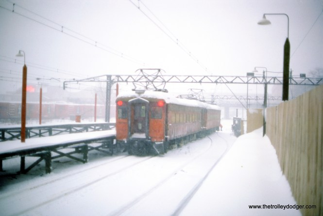 A two-car South Shore Line train, made up of cars 103 and 24, has made it to downtown Chicago during a blizzard in January 1979.