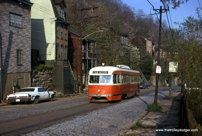 Pittsburgh PCC 1646 on Arlington Avenue in Pittsburgh on April 25, 1974. This trackage serves as a bypass route for a nearby transit tunnel, and I actually have rode on it twice-- the first time was in 1985, when for a short time, it became an actual route, and then again in 2014, on a fantrip. (Joseph Saitta Photo)