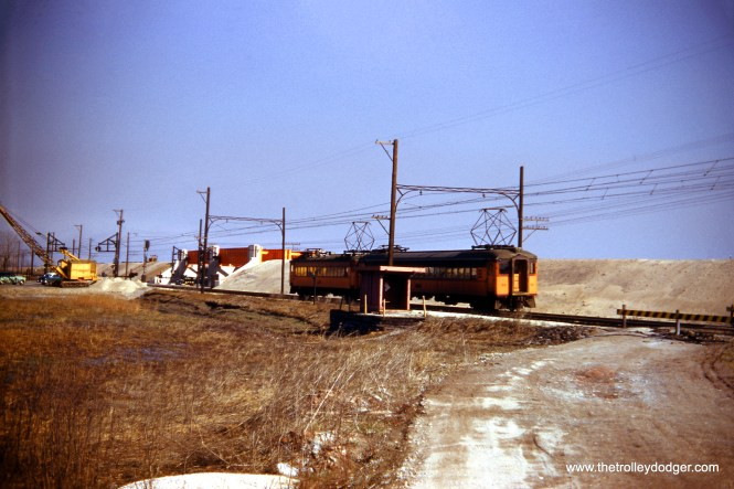 A South Shore Line train at 130th and the under construction Calumet Superhighway in April 1952. (James P. Shuman Photo)