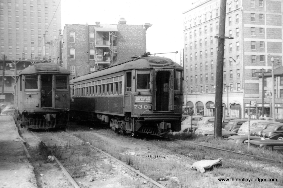 """North Shore Line car 730 on a storage track at the Milwaukee Terminal on August 31, 1942, with a merchandise dispatch (or """"despatch"""") car at left."""