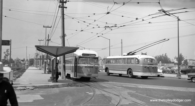 I really have no information about this photo, other than that it might be Mexico City. If I had to guess a date, I would say the early 1960s. What attracted me to it is that you don't see a lot of photos showing a streetcar and a trolley bus together.