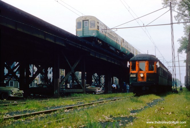 "On September 15, 1957, a southbound CTA train on the north-south ""L"" passes by a North Shore Line train (lead car 420) on a fantrip. The lower level tracks were an interchange connection between the ""L"" and the Milwaukee Road, and were used for freight until 1973. They had once been part of a commuter rail line that the ""L"" took over north of Wilson Avenue that originally ran at ground level to Evanston. The lower level area is now occupied by Challenger Park. (William C. Hoffman Photo)"