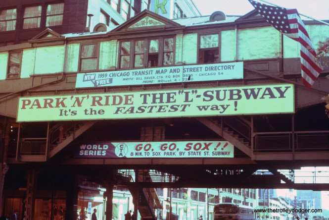 "On September 13, 1959, the Chicago White Sox were in first place in the American League, but had not yet clinched the pennant. That happened on September 22 in Cleveland, after which Fire Commissioner Robert Quinn ordered the air raid sirens to blow here for five minutes. But the CTA was already encouraging baseball fans to take the ""L"" to Comiskey Park for the upcoming World Series, which the pale hose lost in six games to the Los Angeles Dodgers. This is the north face of the CTA ""L"" station at State and Van Buren, which appears largely unchanged since it was built in 1897. This station closed in 1973 and was removed two years later. It was replaced by a new station serving the Harold Washington Library in 1997. (William C. Hoffman Photo) Our resident south side expert M.E. adds: ""My eagle eye says the destination sign on the bus reads ""42 Halsted- Downtown"", which ran along State St. north of Archer Ave. Also: The US flag in the picture is a brand-new, 50-state flag that took effect on 20 August 1959 when Hawaii became the 50th state. The tall building at the left would be the Sears store on the southeast corner of State and Van Buren."""