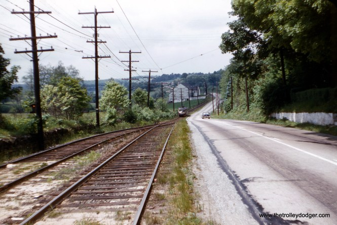 J. W. Vigrass shot this photo of the Red Arrow operating along West Chester Pike on May 29, 1954. Much of the line was single track, and here we are at a passing siding.