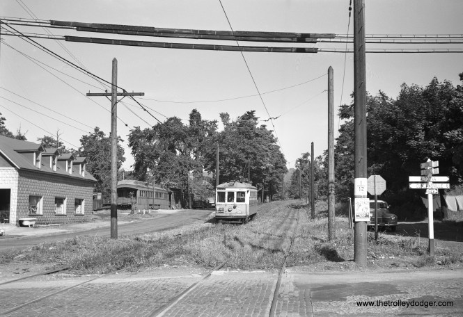 I assume this is Altoona & Logan Valley car 62 in the early 1950s. Not sure what the two former railroad coaches are at left, repurposed after their retirement.