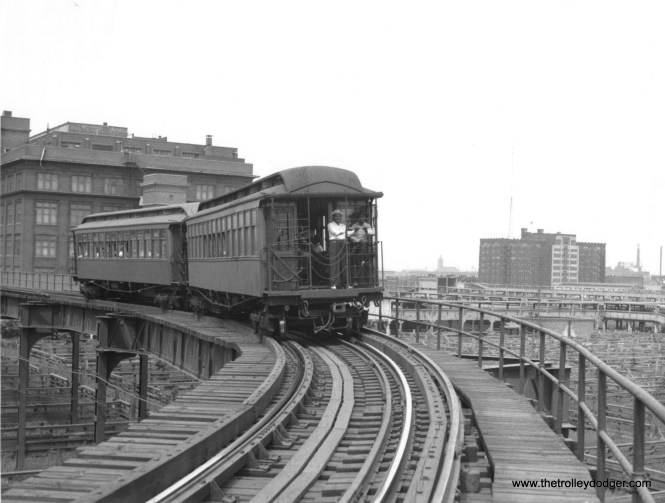"""A two-car train of wooden """"L"""" cars on the single-track Stock Yards branch in 1946. This photo has been attributed to Charles Keevil."""