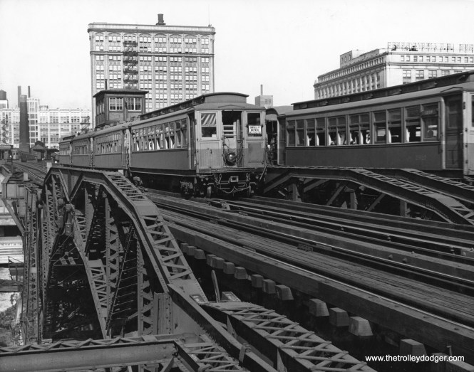 An eastbound Garfield Park train approaches the Loop in the 1940s, crossing over the Chicago River. (Chicago Transit Authority Historical Collection)