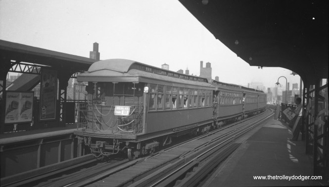 """A Douglas Park """"B"""" train heads west at Halsted on the Met main line, prior to the removal of two tracks for expressway construction."""