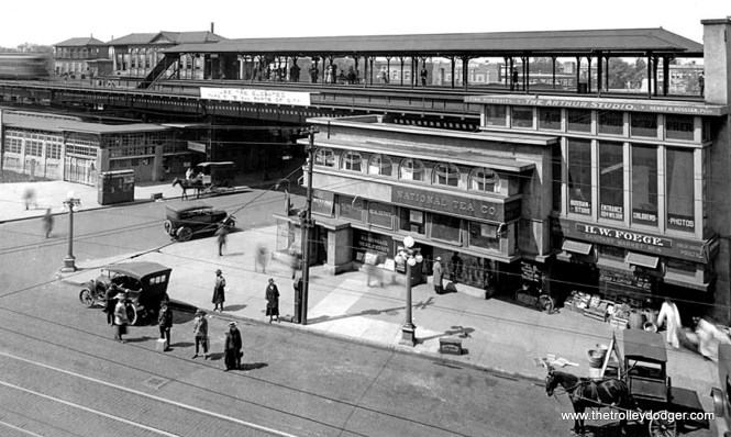 """Frank Lloyd Wright designed the triangular Stohr Arcade Building at Wilson Avenue and Broadway in 1909, part of which was underneath the Northwestern """"L"""" structure. Within a decade of its construction, """"L"""" service led to rapid development of the Uptown neighborhood, and the Stohr Arcade was replaced by Arthur U. Gerber's Uptown Union Station in 1923. (Krambles-Peterson Archive)"""