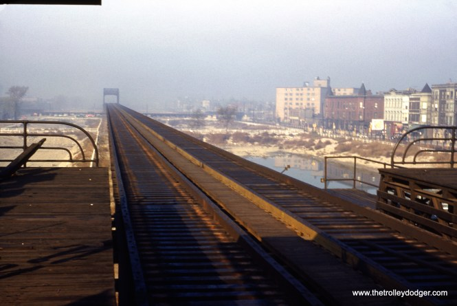 """The view looking west from the former Western Avenue station on the Garfield Park """"L"""" on October 16, 1953. The """"L"""" tracks have already been removed and demolition of the station would follow shortly. The last train ran on this structure (in one direction) on September 27. (William C. Hoffman Photo)"""