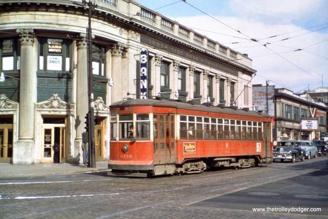 """The info on the slide mount says this is CTA 6153 at 47th and Indiana in June 1949. However, the car is signed for Route 28. Kevin Doerksen says this is """"actually 47th and Cottage Grove, NE corner. The old bank building is still there."""" (William Shapotkin Collection)"""