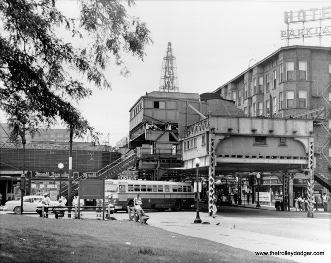 """This is how the end of the Jackson Park """"L"""" looked for many years at 63rd Street and Stony Island Avenue. The """"L"""" had gone about a block further east during the 1893 World's Columbian Exposition to connect to the experimental Columbian Intramural Railway. In this early 1950s view, a CTA 63rd Street bus has turned the corner onto Stoney Island, as this was the end of the line. Behind the """"L"""" station, we can see a sign advertising the Tower Theater, open from 1926 to 1956, built by the Lubliner and Trinz chain. (Chicago Transit Authority Historical Collection)"""