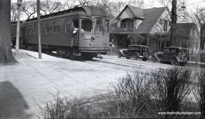 """North Shore Line wood car 305 (former Chicago & Milwaukee Electric) in Kenilworth circa 1930, running as a Chicago local on the Shore Line Route. Don's Rail Photos: """" 303 thru 305 were built by American Car in 1910 and were almost identical. In 1939 they became sleet cutters and were retired and scrapped in 1940."""" (Kenilworth Historical Society)"""