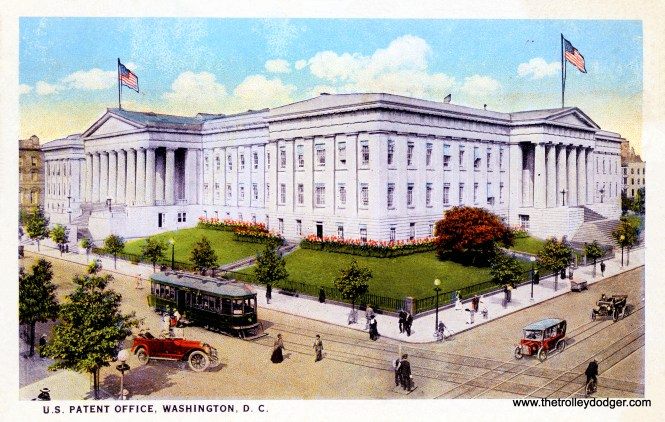 The U.S. Patent Office in Washington, DC in the 1920s, with a streetcar out front, apparently powered by conduit via a electric plow running in a trough between the two rails.