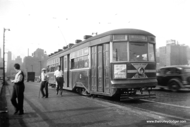 """CSL """"Sedan"""" (aka Peter Witt) 6283 appears to be southbound on Clark, just south of downtown, in this circa 1940 photo. Don's Rail Photos: """"6283 was built by CSL in 1929."""" This might seem unusual, that the Surface Lines had the capability or even the desire to build their own streetcars. But CSL was very much involved with the project that eventually created the PCC car just a few years after this, and it was CSL and not the ERPCC that had the two experimental pre-PCCs (4001 and 7001) built in 1934. Eventually, the CTA became the largest stockholder in the Transit Research Corporation, the successor to the ERPCC."""