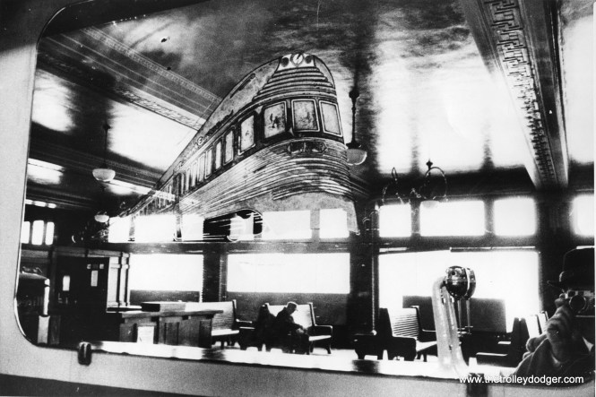 This photo, showing a mirror at the North Shore Line's Milwaukee terminal, was taken on January 21, 1963 (after abandonment) by Allan Y. Scott for the Milwaukee Journal. You can see the photographer in the picture, apparently using a Leica M2 or M3. This picture came from the collection of the late John Horachek. Rather than being a double exposure, it seems like the ghostly image of an Electroliner was applied to the mirror using a stencil and a product known as Glass Wax.