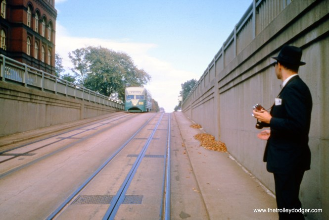 Raymond DeGroote, Jr. waits for DC Transit pre-PCC streetcar 1053 to descend a viaduct in Washington, DC on October 15, 1961, so he can get his picture. Streetcars in portions of the District of Columbia were forbidden to use overhead wire, and were powered by an underground conduit instead. (William C. Hoffman Photo)