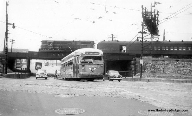 I assume that CTA PCC 4300 is turning from Archer onto Clark, running a northbound trip on Route 42 - Halsted-Downtown, and that we are looking to the southwest. Note the Rock Island train in the background. Metra Rock Island District trains still use these tracks.