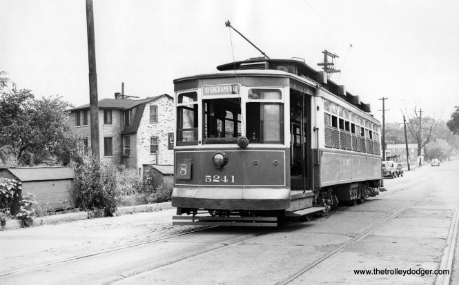 """CSL 5241 is southbound on Through Route 8, Halsted. Bill Shapotkin adds, """"The car (signed for destination of 111/Sacramento and probably a school tripper for Morgan Park High School) is standing W/B in 111th St JUST EAST of Vincennes Ave. That house with the distinctive roof (left) still-stands today. View looks east."""""""