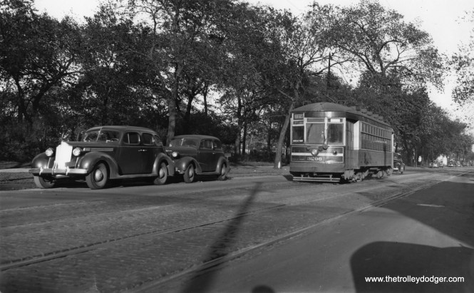 CSL 3296 is on Montrose. Could this be westbound at Welles Park? Note the Packard at left.