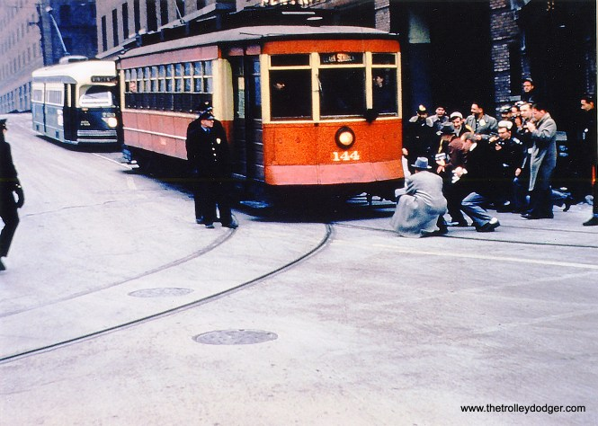 This is actually a picture of CTA 225 at Dearborn and Kinzie, on a December 18, 1955 fantrip, where it was disguised as 144 with a piece of oilcloth. The story goes that Maury Klebolt, who organized this trip, had advertised that car 144 would be used, and for some reason, it was not available that day. 225 was later sold to the Seashore Trolley Museum, where it remains today, while 144 is at the Illinois Railway Museum.