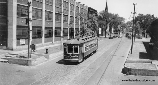 CSL 3307 is westbound on Montrose, about to cross under the Chicago & North Western railroad at about 1800 West.