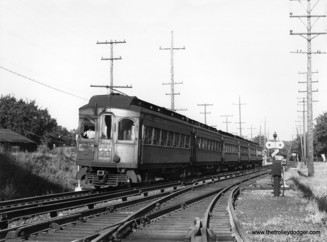 A CA&E train of woods, headed up by car 26, at an undetermined location.