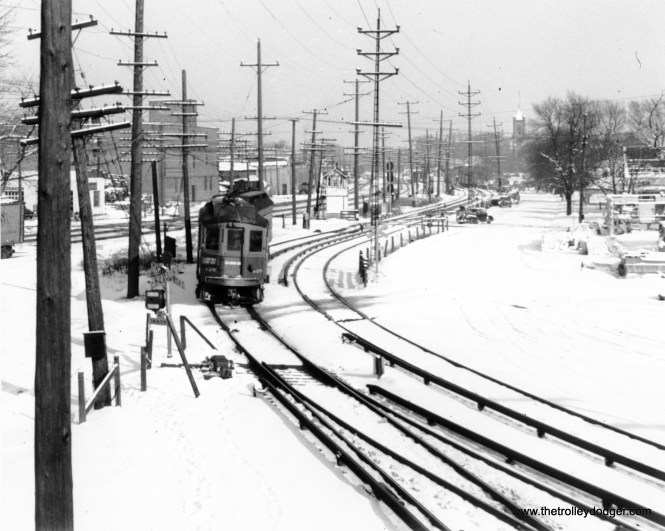 """Not sure where this is. Could it be Wheaton? Dann Chamberlin: """"Yes, it is. The Wheaton yard and shops are to the rear of the photographer. The photo looks east towards downtown Wheaton. Note the tower of the DuPage County courthouse in the right-rear of the photo."""""""