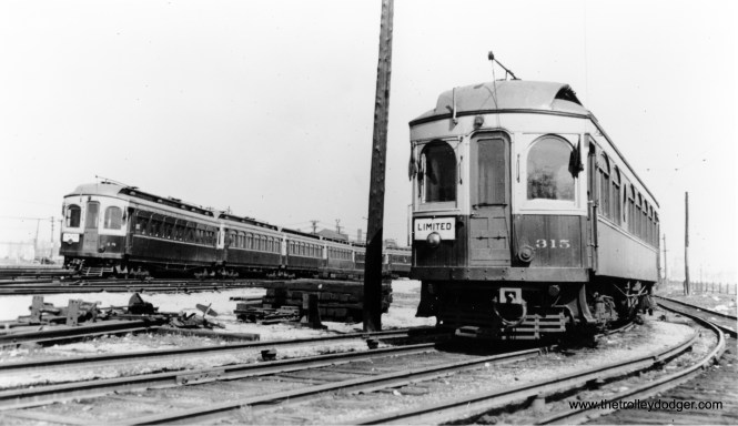 """CA&E 48 at left, with 315 at right. Can this be Wheaton? Don's Rail Photos: """"315 was built by Kuhlman Car Co in 1909, #404. It was modernized at an unknown date and sold to Rockhill Trolley Museum in 1962."""" (Joe L. Diaz Photo)"""