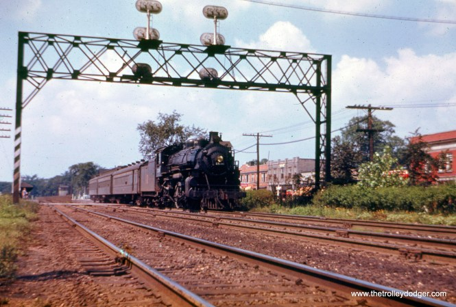 """An eastbound C&NW """"scoot"""" (commuter train) has just departed the Elmhurst station and is seen crossing York Road. The view looks west. (William Shapotkin Collection)"""