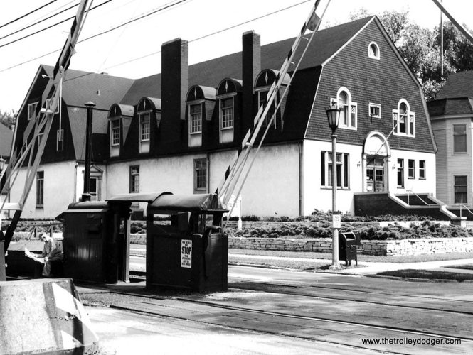 """Michael Franklin writes: """"This (aaa397) is looking north on Kenilworth. The twin spires in the background are the church on the NE corner of Kenilworth and Lake. The long gone Oak Leaves Offices are on the right. Building demolished in 1971."""" Here we see the same building from a different angle, looking to the southeast across the """"L"""" right-of-way."""