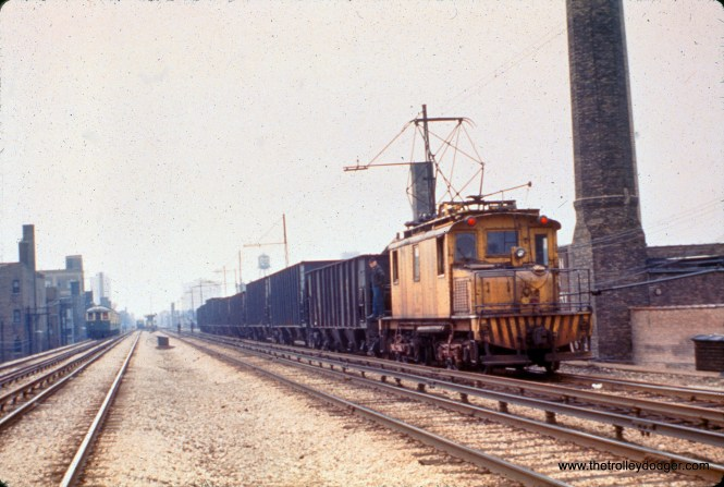 """A CTA freight train is on the north side """"L"""" in this undated photo, looking south. Electric freight service was the """"L""""s responsibility from 1920 to 1973, a holdover from the days when this was a Milwaukee Road line operating at ground level."""