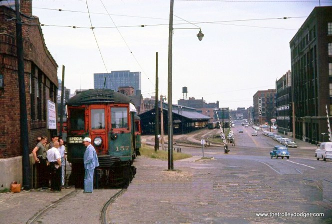 This was a slide that was recently sold on eBay that I did not win. North Shore Line car 157 is apparently on a fantrip at the Milwaukee Terminal in the early 1960s, with the Milwaukee Road's train shed in the background.