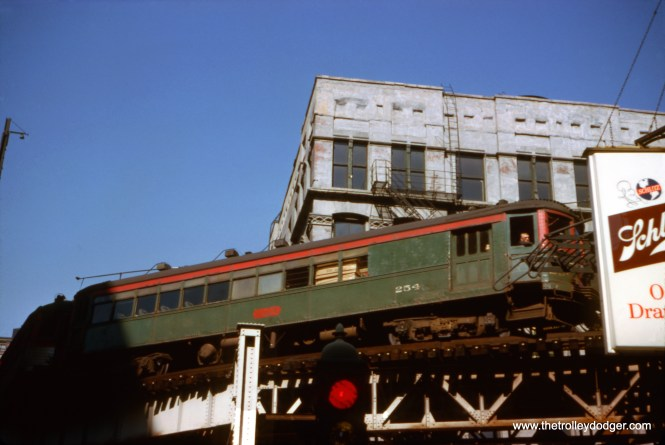 """This picture of North Shore Line car 254 on the """"L"""" in August 1962 generated a lot of discussion on the Facebook Trolley Dodger group. First of all, where is it? Jon Habermaas has identified it as the Harrison Curve at Harrison and Wabash. He also says that the train is northbound, turning onto Wabash, as the location of the combine as the lead car shows."""