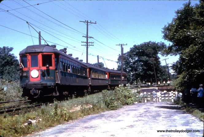 This is Glencoe on the North Shore Line's Shore Line Route. The circular white sign would indicate this was a Central Electric Railfans' Association fantrip, possibly just prior to the 1955 abandonment.