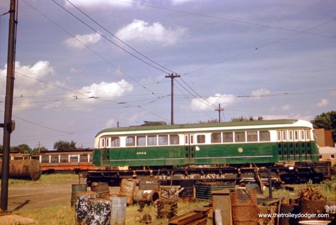 The Chicago Surface Lines put the first of 83 prewar PCCs into service in November 1936, and all ended service in June 1956 on Route 49 - Western. This picture, showing 4004 loaded onto a flat car, with the trucks and pole removed, was probably taken in either late 1956 or early 1957, when the car was taken from South Shops to a local scrapyard.