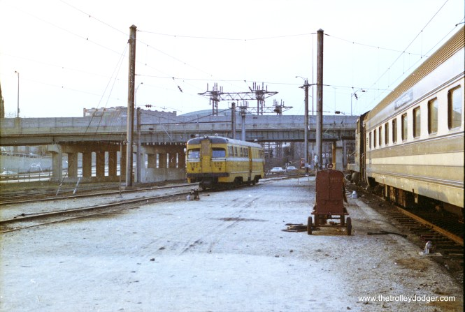 Sperry Rail Service Mack PCC railbus in the coach yard at Pennsylvania Station. 623 also shows a Baldwin switcher. At this time Baltimore still had a full time station switcher