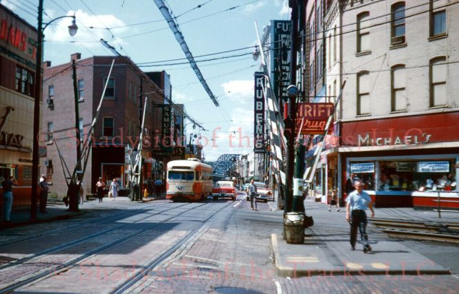 """FYI, this 35mm slide recently sold for $263.88. Pittsburgh Railways PCC Electric Streetcar #1470 Original Kodachrome Color Slide Processed by Kodak McKeesport, Pennsylvania 7 September 1959 Photographer Credit: William D. Volkmer Bob Sherwood writes, """"This photo was taken during a Photo Stop during the NRHS Convention trip. My Dad, W. G. Sherwood, is on the sidewalk to the right walking toward the cameraman."""""""