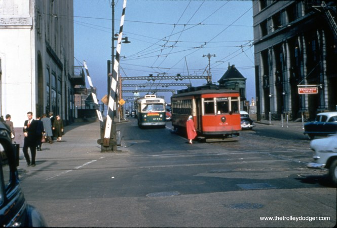 On May 18, 1954, a Route 8 - Halsted streetcar shares wire with a Chicago Avenue trolley bus by the Montgomery Wards complex. We are looking west. The Halsted car is on diversion trackage. (William C. Hoffman Photo, William Shapotkin Collection)