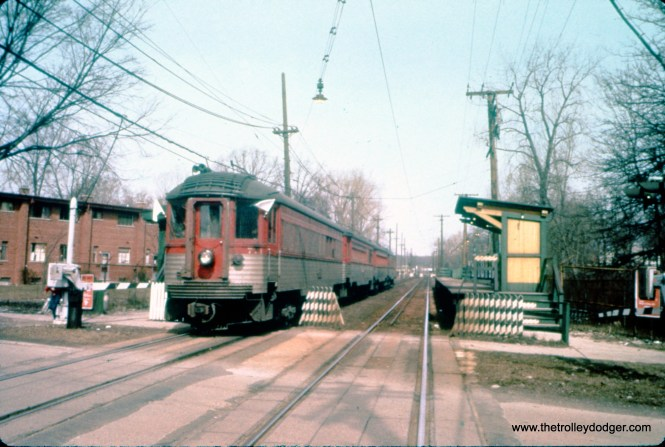 On March 25, 1962, NSL cars 771, 415, 753, and 251 are on a Central Electric Railfans' Association fantrip at the Isabella station in Evanston, where no North Shore cars had been since the Shore Line Route was abandoned in 1955. (William C. Hoffman Photo, William Shapotkin Collection)