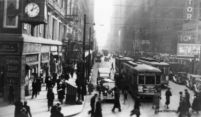 The Route 22 streetcar means this is Clark Street, and I believe that's the old Astor Theater at right, so this is Clark and Madison looking south. The film Murder in the Fleet was released in 1935, but from the looks of the autos, this is a few years later, so most likely about 1938. (William Shapotkin Collection)