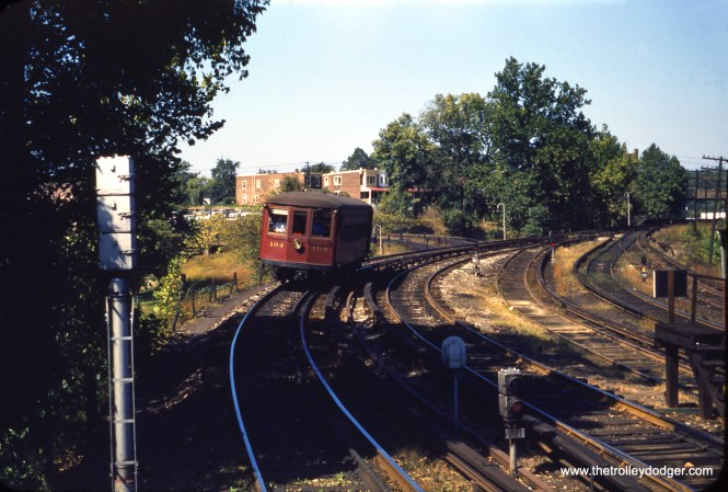 """Red Arrow Strafford car 164 is on the high-speed line to Norristown in the early 1950s, perhaps near 69th Street Terminal. Kenneth Achtert adds: """"Your picture of Strafford car #164, if the early 1950s date is accurate, was most likely not on a Norristown line trip, but is arriving at 69th St. Terminal likely coming from Strafford. Strafford service was not abandoned until 1956 and was what gave the 160-series cars their common name. The bullet cars could have been called Norristown cars, but they already had an even better name."""""""