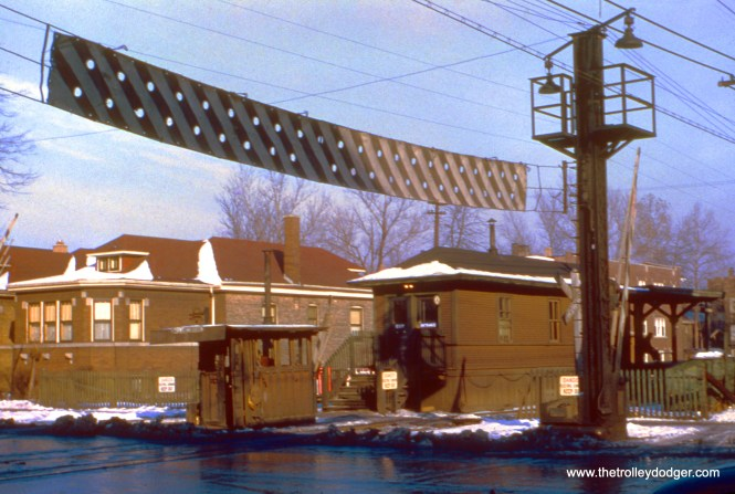"""The CTA ground-level station at Austin Boulevard in Cicero, on the Douglas Park """"L"""" in December 1950. Note the unusual raised barrier at the crossing. (Truman Hefner Photo)"""
