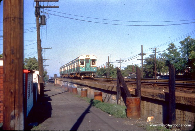 """In May 1952, a CTA train of flat-door 6000s heads down an incline west of Pulaski Road on the Douglas Park """"L"""". (Truman Hefner Photo)"""