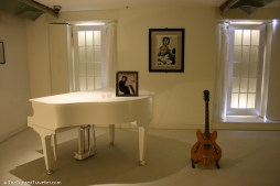 John Lennon's piana and guitar in The Beatles Story Museum, Liverpool - See the Best of England: A Three Week Itinerary - The Trusted Traveller