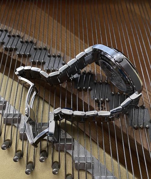 OMEGA Aqua Terra on piano