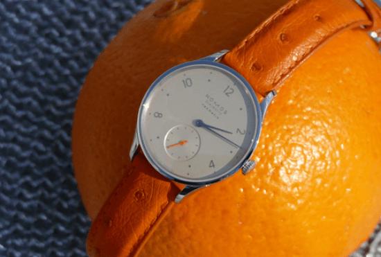 NOMOS on orange