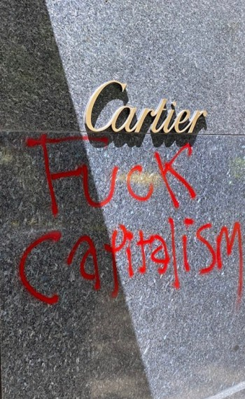 Grafitti at Cartier watch store looting site