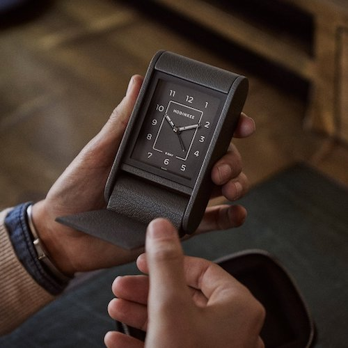 HoDinkee travel clock in hand